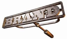 Branding iron with the word BRAND